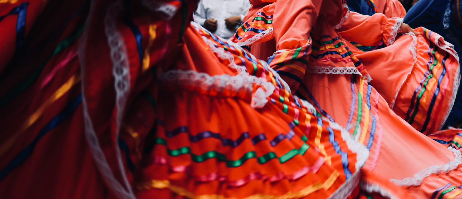 people dancing in traditional clothing